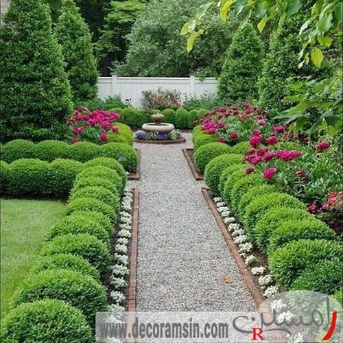 عکس-محوطه-سازی-ورودی-ویلا-با-استفاده-از-سنگفرش-و-کاشت-گیاهان-سبر-در-اطراف