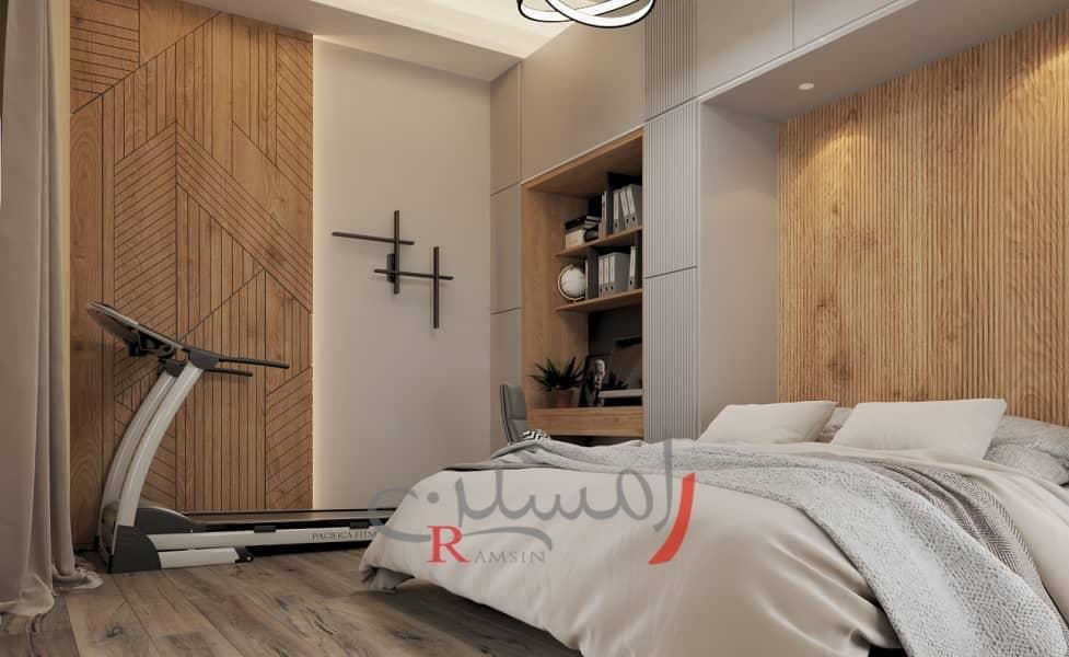 دکوراسیون اتاق خواب مهمان با دیوار های چوب ترمووود و تردمیل به همراه میز کار_new