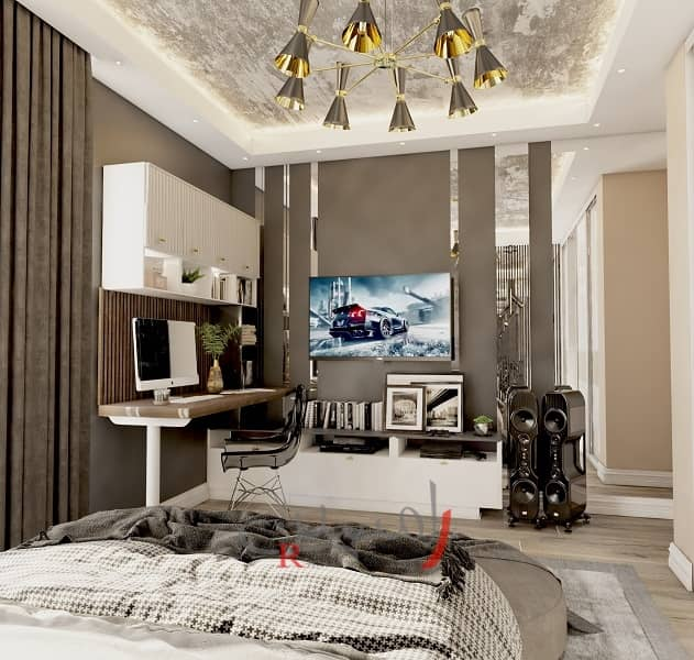 دکوراسیون اتاق خواب پسر نوجوان با میز کار بزرگ چوبی و تلویزیون و قاب بندی های طلایی و لوستر سقف زیبا_new